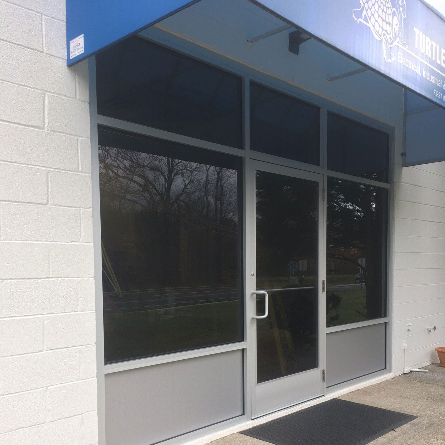 Single glass storefront door - Everything Was Finished Off In Clear Anodized Aluminum Break Metal And Caulked For A Water Tight Seal From The Elements